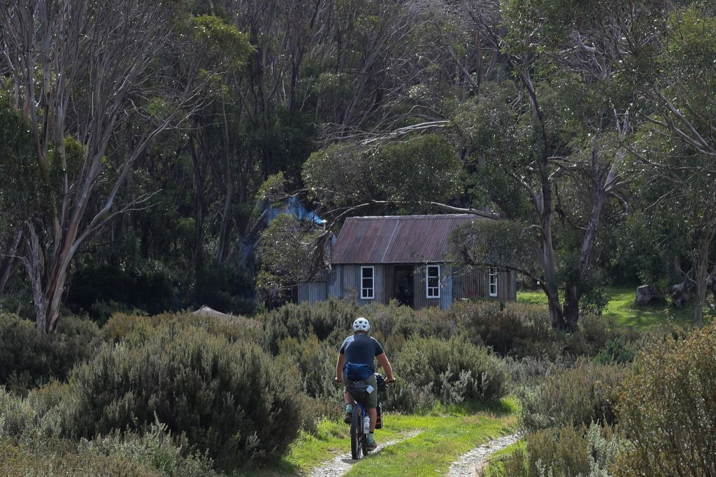 Bikepacking rider approaching Horse Camp Hut