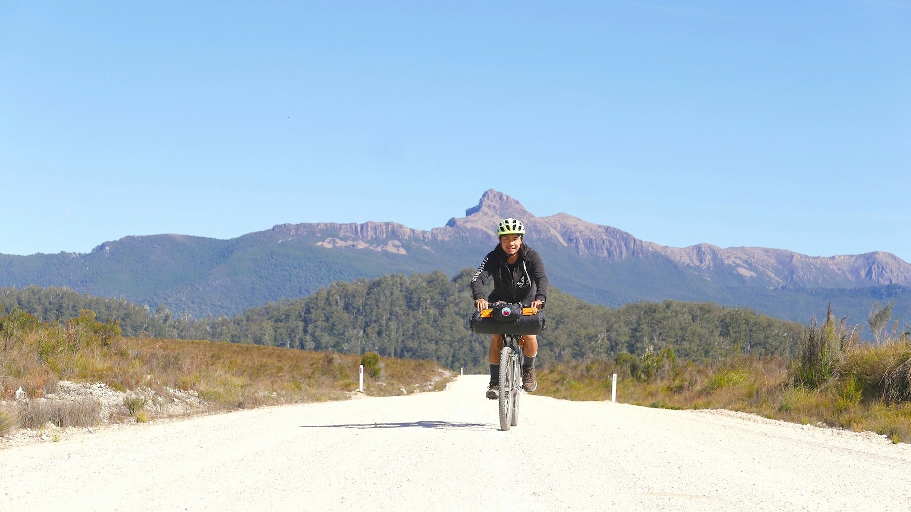 bikepacking in Western Tasmania with the Western Arthur Mountain Range behind