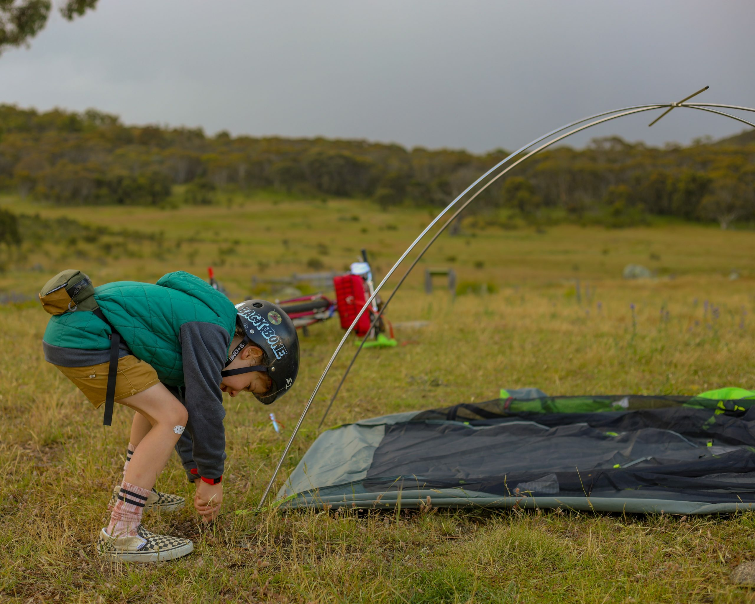 Bikepacking with a six year old, helping to put up the tent