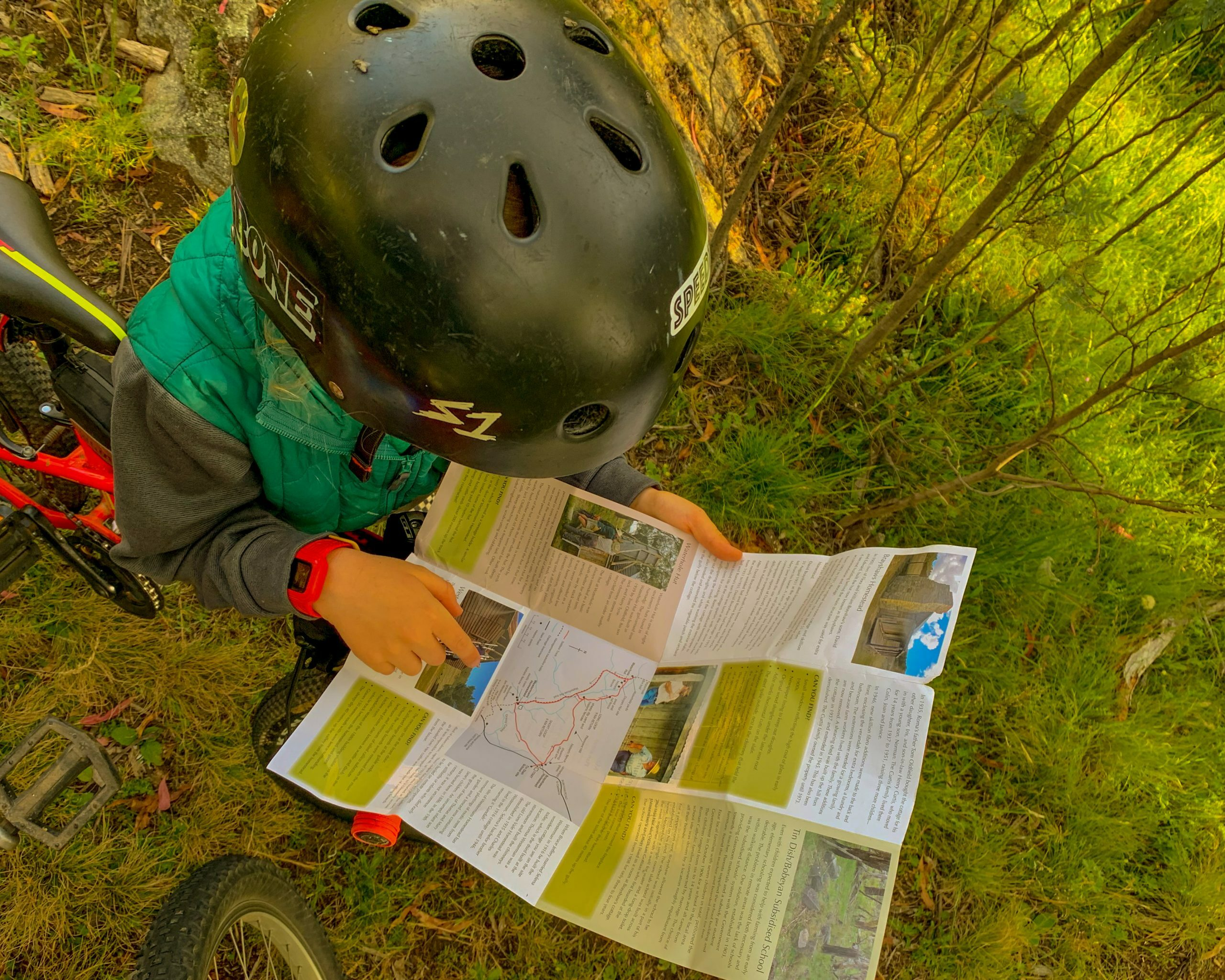 Bikepacking with a six year old , helping to read the map