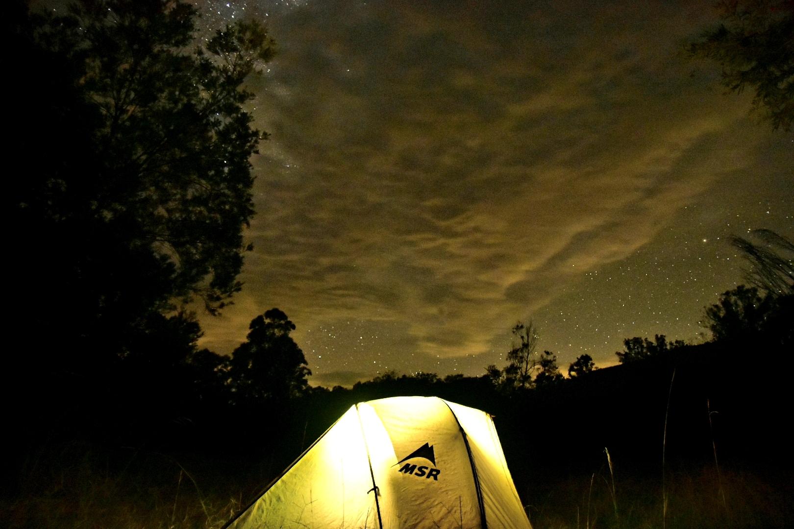 Bikepacking tent under a night sky in Monkerai