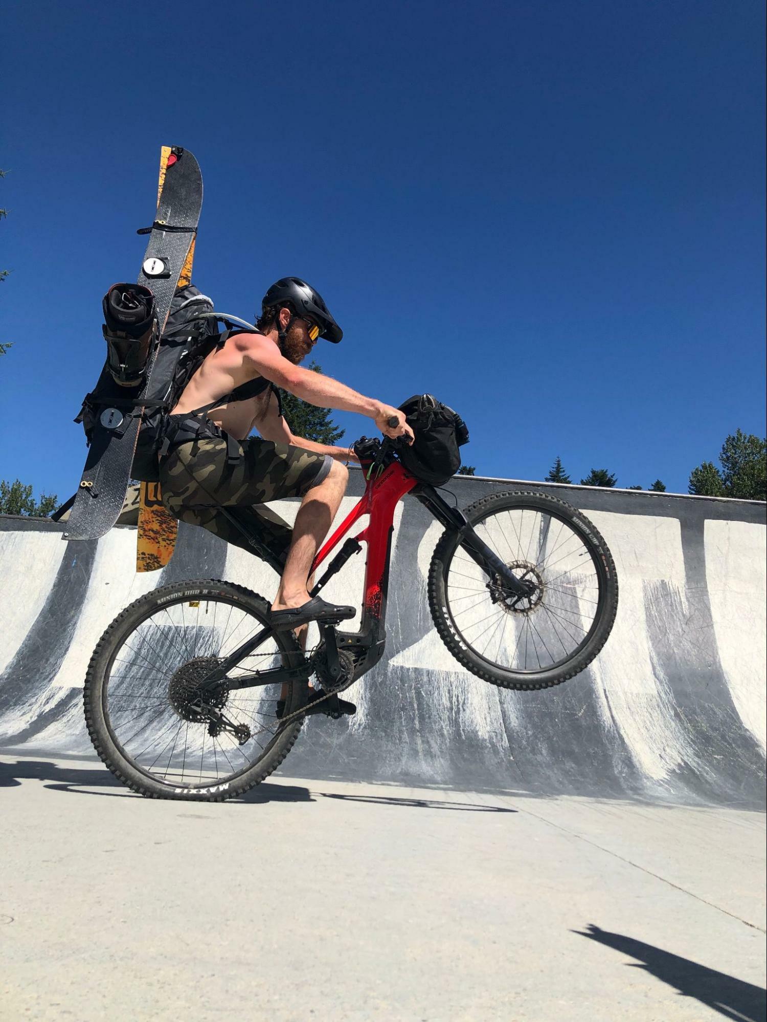Bikepacking wheelie in the skatepark