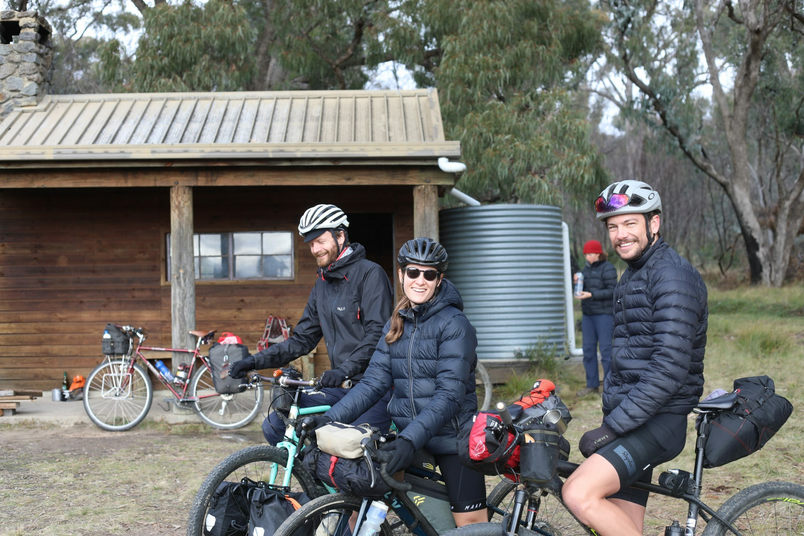 Bikepackers outside Brandy Flat Hut in Namadgi national park
