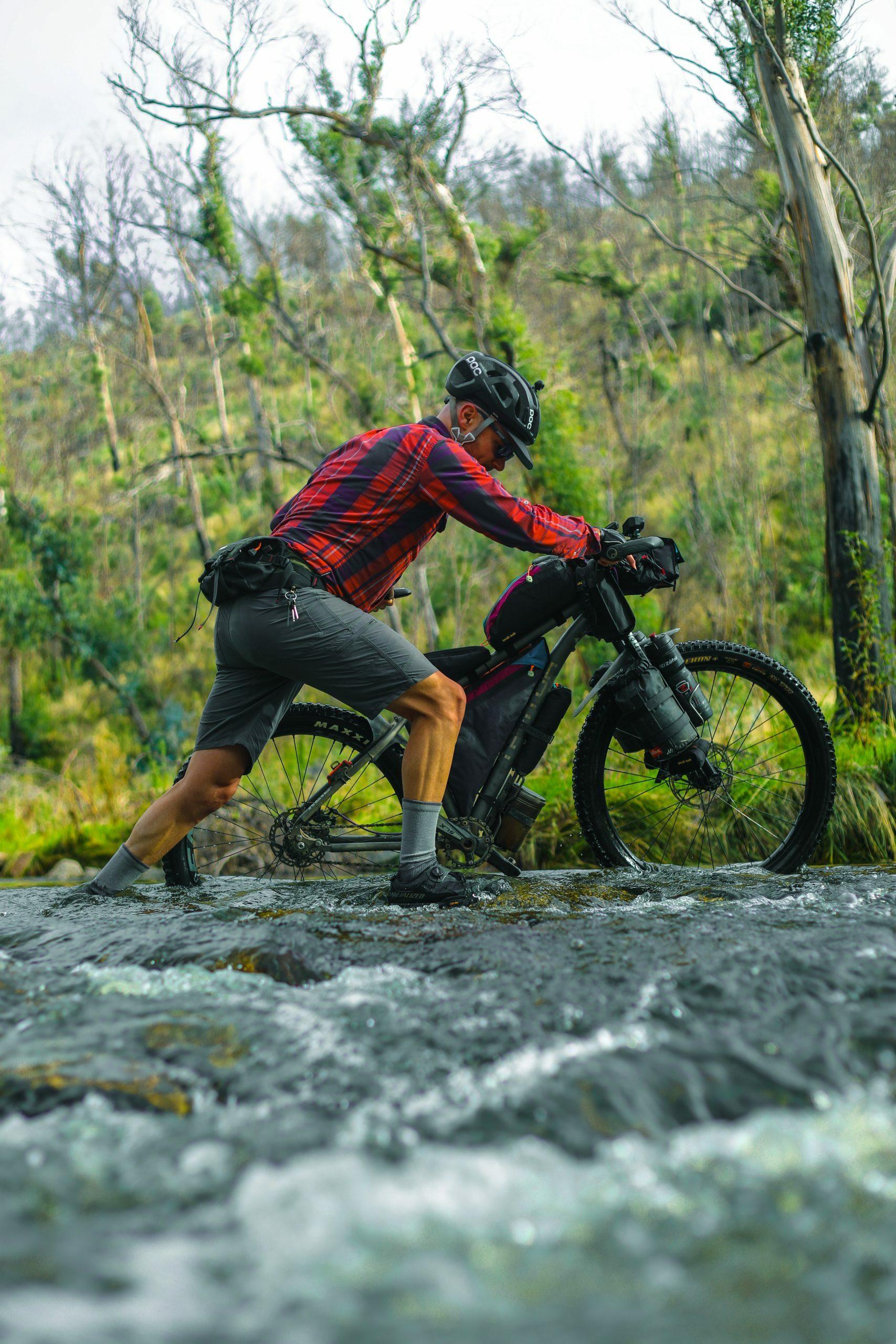 Pushing the bikepacking bike across the Naas River
