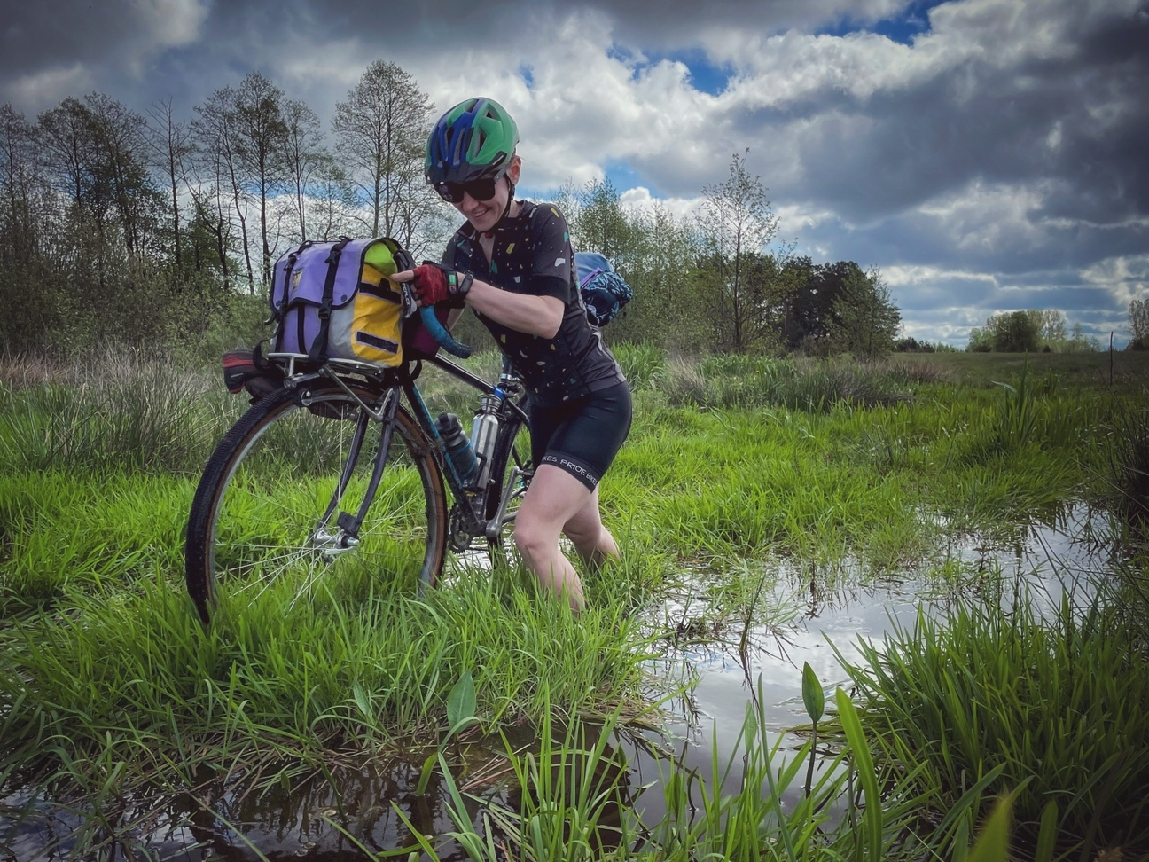 Hike a bike photo from Helen Semchenko Pushing through a river bog in Ukraine