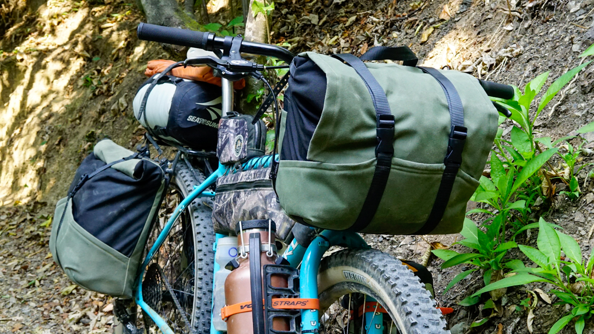 Framework Designs overlander bikepacking handlebar bag and custom panniers