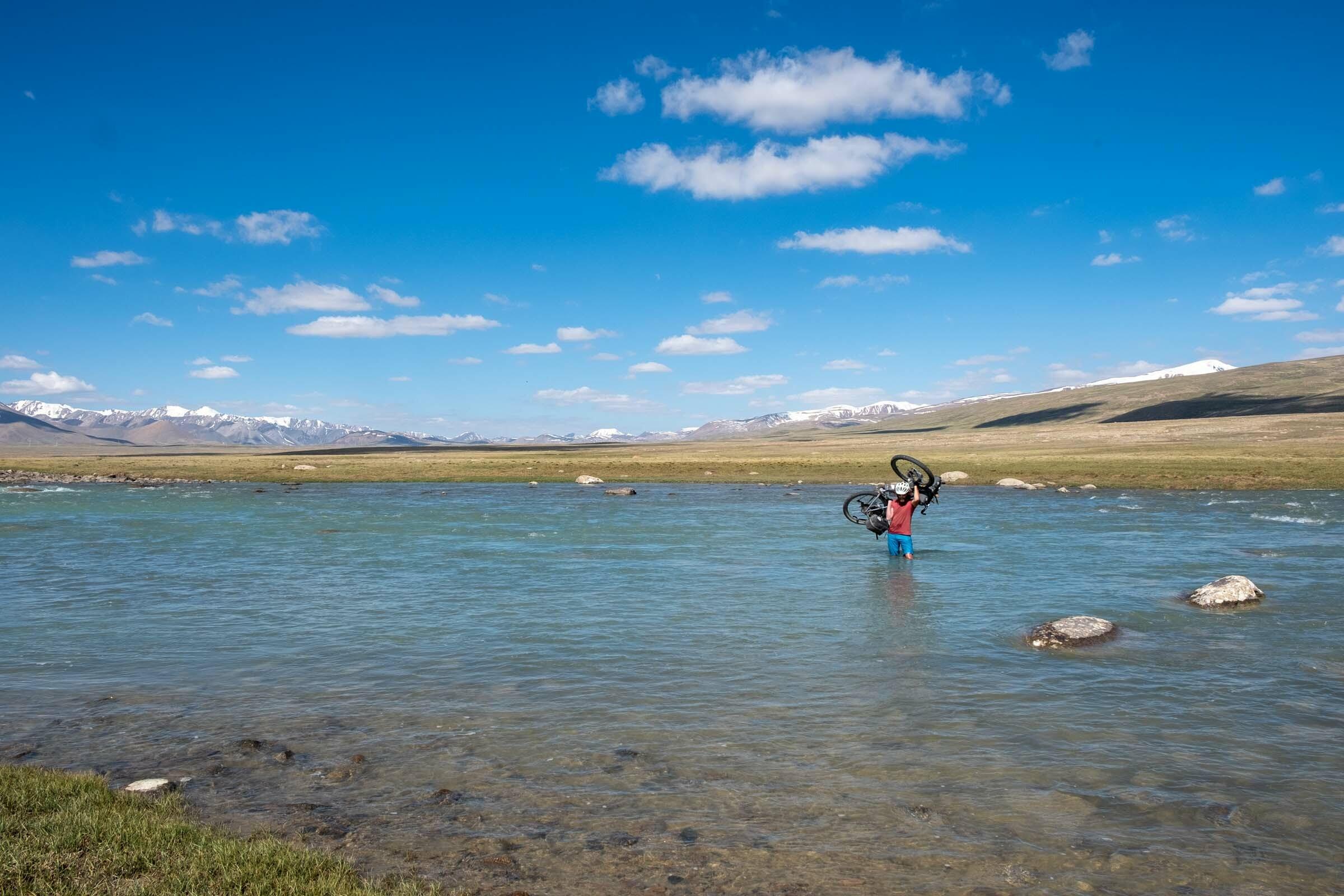 River crossing while bikepacking in Kyrgyzstan