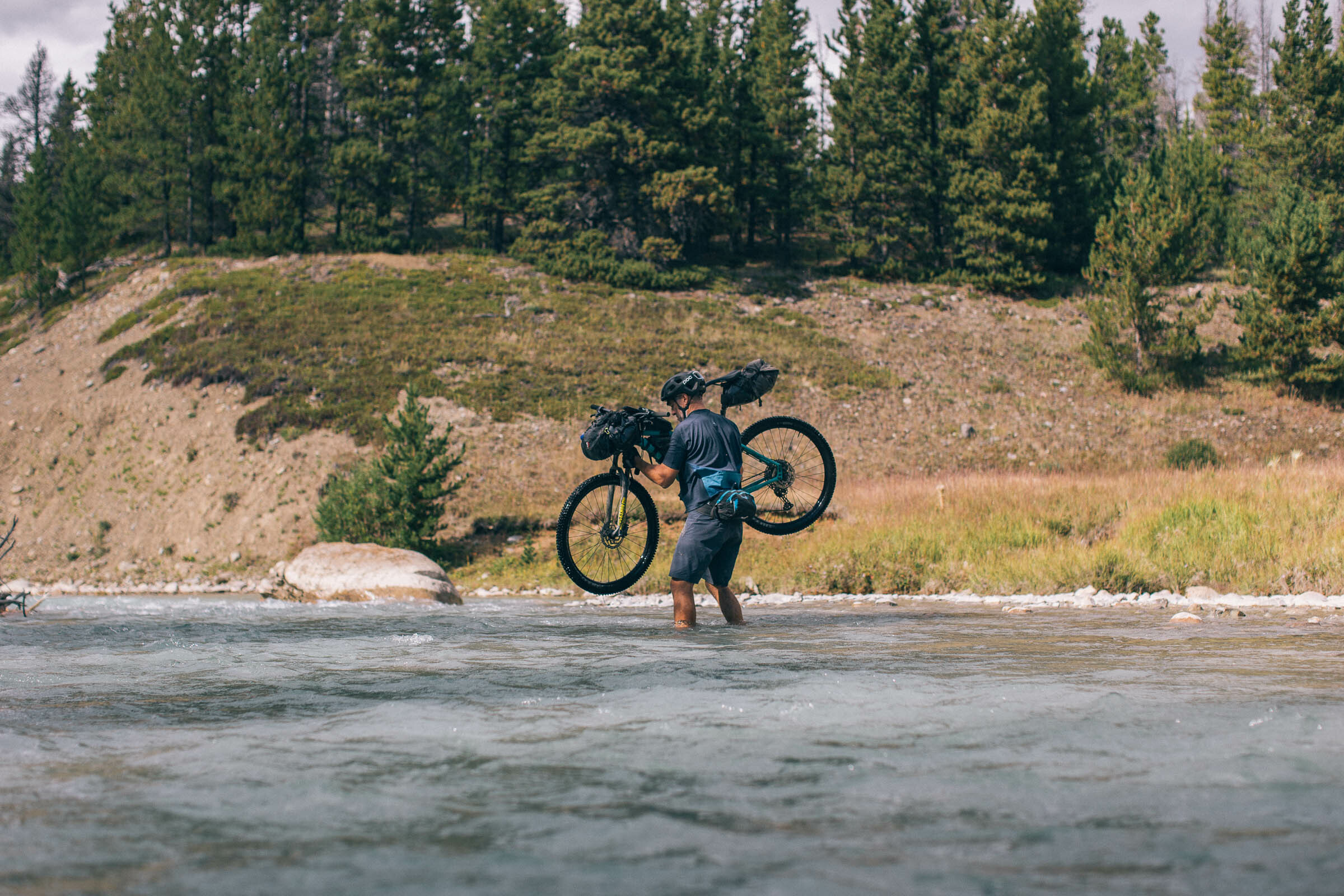River crossing with a bicycle in Canada, photo by Miles Arbour