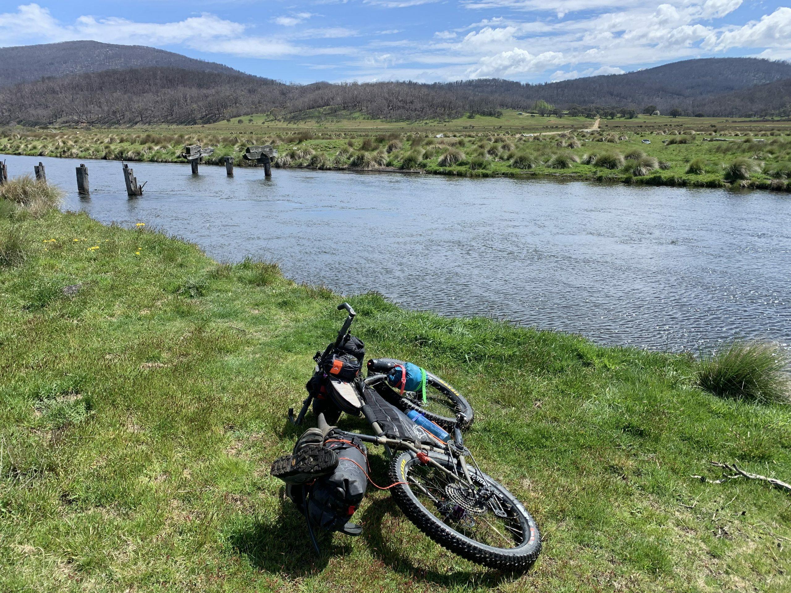 Crossing the encumbene river heading in the Jagungal on a bikepacking trip