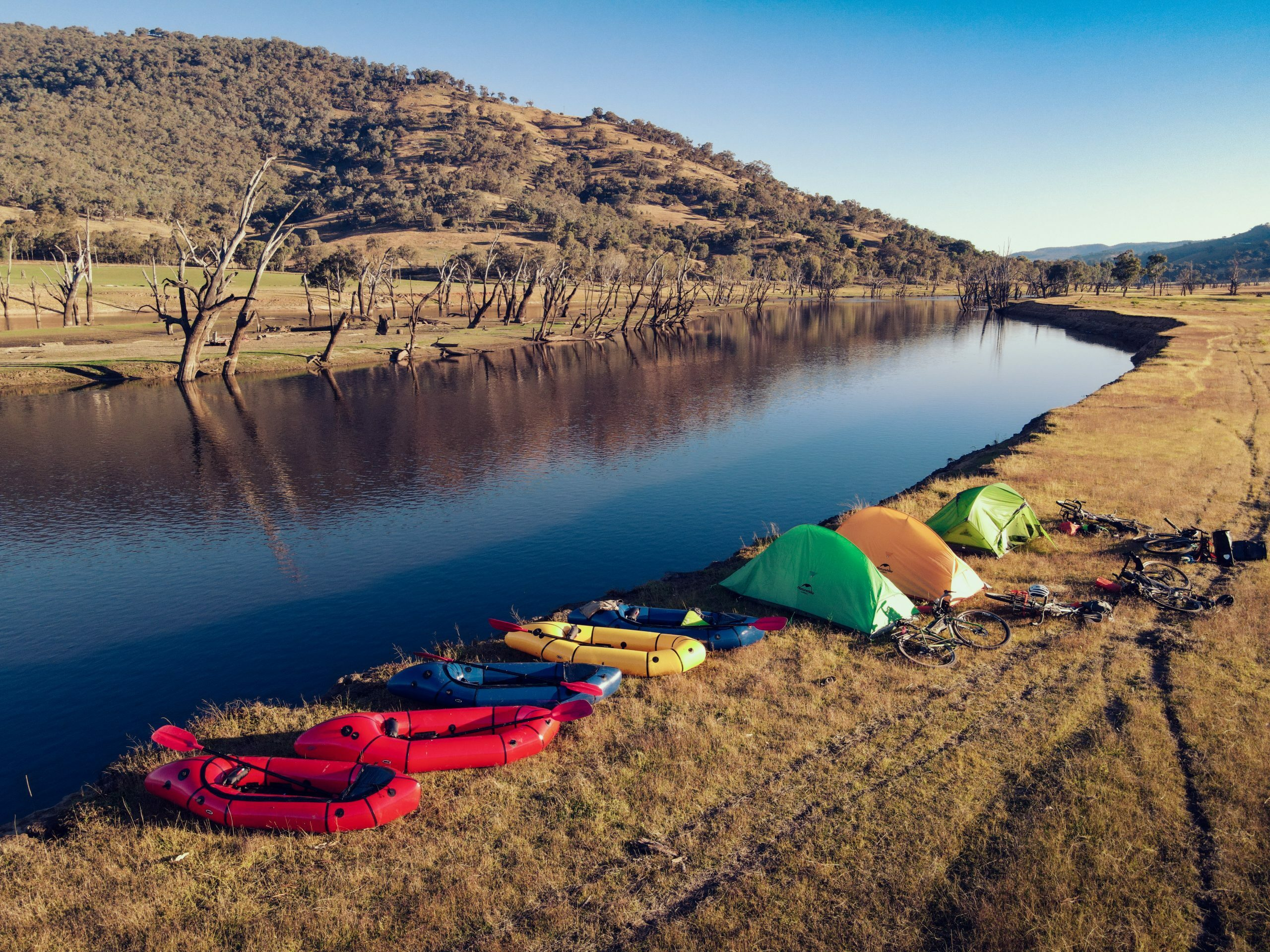 Packrafts and campsite on the bank of the Murray River